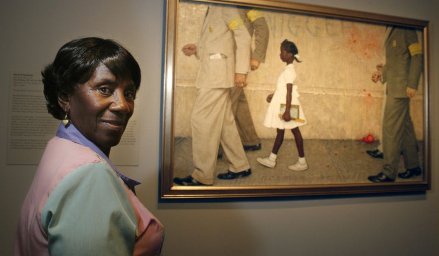 """FILE - In this July 20, 2006, file photo, Lucille Bridges poses next to the original 1964 Norman Rockwell painting, """"The Problem We All Live With,"""" showing her daughter Ruby, inside the Museum of Fine Arts in Houston. Bridges, a Hurricane Katrina evacuee and Houston resident after the storm, looked for the first-time at the Rockwell original capturing her oldest daughter, Ruby, as she was escorted by U.S. marshals into an all-white New Orleans school during integration nearly a half-century earlier. New Orleans' mayor announced Tuesday, Nov. 10, 2020, that Lucille Bridges, the mother of civil rights activist Ruby Bridges, has died at the age of 86. (Steve Ueckert/Houston Chronicle via AP, File)"""