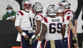 New England Patriots quarterback Cam Newton, left, celebrates his touchdown during the first half of an NFL football game against the New York Jets, Monday, Nov. 9, 2020, in East Rutherford, N.J. (AP Photo/Bill Kostroun)