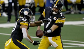 Pittsburgh Steelers running back James Conner (30) takes the hand off from quarterback Ben Roethlisberger (7) in the first half of an NFL football game against the Dallas Cowboys in Arlington, Texas, Sunday, Nov. 8, 2020. (AP Photo/Ron Jenkins)