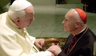 In this Feb. 23, 2001, file photo, U.S. Cardinal Theodore Edgar McCarrick, archbishop of Washington, D.C., shakes hands with Pope John Paul II during the General Audience with the newly appointed cardinals in the Paul VI hall at the Vatican. McCarrick was one of the three Americans on a record list of 44 new cardinals who were elevated in a ceremony at the Vatican on Feb. 21, 2001. (AP Photo/Massimo Sambucetti, File)