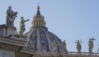Statues top the facade of St. Peter's Basilica at the Vatican, Tuesday, Nov. 10, 2020. A Vatican investigation into ex-Cardinal Theodore McCarrick has found that bishops, cardinals and popes downplayed or dismissed reports that he slept with seminarians. But the 400-plus-page report determined that Pope Francis merely continued his predecessors' handling of the predator until a former altar boy alleged abuse. (AP Photo/Andrew Medichini)