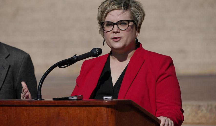 Oklahoma state Rep. Emily Virgin, D-Norman, calls for a state face mask mandate during a news conference Tuesday, Nov. 10, 2020, in Oklahoma City. (AP Photo/Sue Ogrocki)