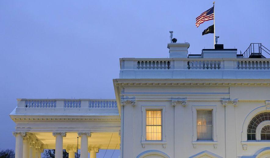 Lights shine from inside the White House at dusk, Wednesday, Nov. 11, 2020, in Washington. (AP Photo/Patrick Semansky)