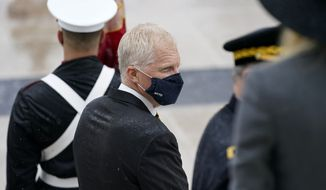Acting Secretary of Defense Christopher Miller attends a Veterans Day wreath laying ceremony led by President Donald Trump at the Tomb of the Unknown Soldier at Arlington National Cemetery in Arlington, Va., Wednesday, Nov. 11, 2020. (AP Photo/Patrick Semansky)
