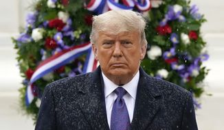 President Donald Trump participates in a Veterans Day wreath laying ceremony at the Tomb of the Unknown Soldier at Arlington National Cemetery in Arlington, Va., Wednesday, Nov. 11, 2020. (AP Photo/Patrick Semansky)