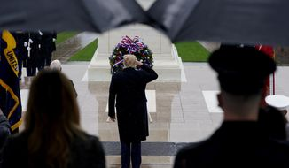 President Donald Trump observes Veterans Day at Arlington National Cemetery in Arlington, Va., Wednesday, Nov. 11, 2020. (AP Photo/Patrick Semansky) (AP Photo/Patrick Semansky)