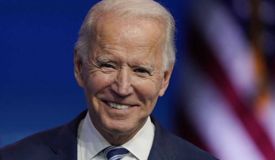 President-elect Joe Biden pauses as listens to media questions at The Queen theater, Tuesday, Nov. 10, 2020, in Wilmington, Del. (AP Photo/Carolyn Kaster)
