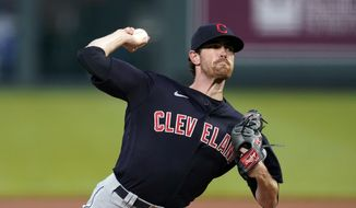 In this Aug. 31, 2020, file photo, Cleveland Indians starting pitcher Shane Bieber throws during the first inning of the team's baseball game against the Kansas City Royals in Kansas City, Mo. Bieber won the AL Cy Young Award on Wednesday night, Nov. 11, 2020. (AP Photo/Charlie Riedel, File) **FILE**
