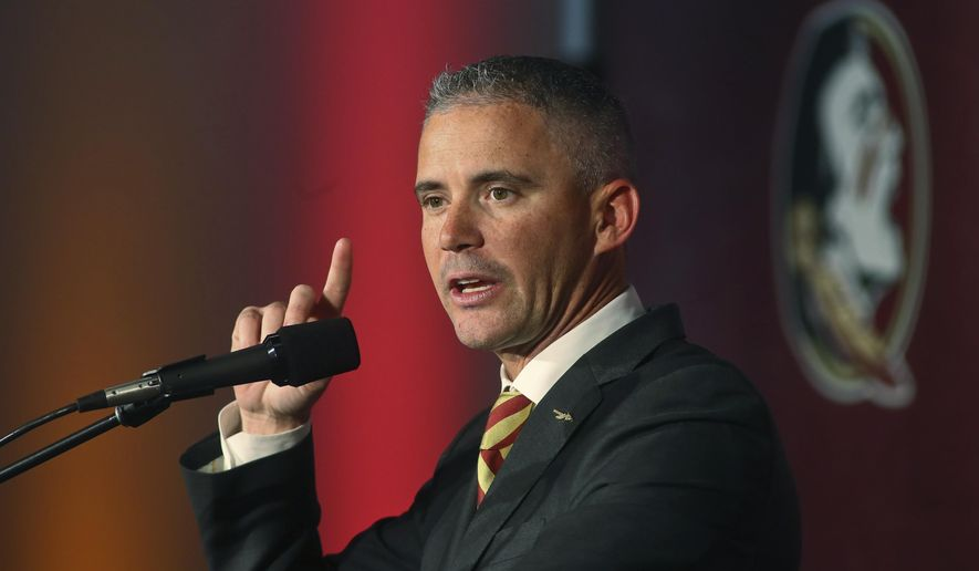 FILE - In this Sunday, Dec. 8, 2019, file photo, Florida State head football coach Mike Norvell speaks at a news conference in Tallahassee, Fla. Florida State's struggles continue to mount. On Wednesday, Nov. 11, 2020, the Seminoles lost several players for the rest of the season, some to injuries and others say it is time to move on. (AP Photo/Phil Sears, File)