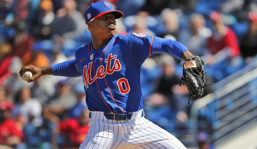FILE - In this Feb. 28, 2020, file photo, New York Mets pitcher Marcus Stroman throws during the first inning of a spring training baseball game against the St. Louis Cardinals in Port St. Lucie, Fla. Stroman and San Francisco starter Kevin Gausman accepted qualifying offers Wednesday, Nov. 11, receiving one-year deals to stay with their teams rather than test what they could get in free agency. (AP Photo/Jeff Roberson, File)