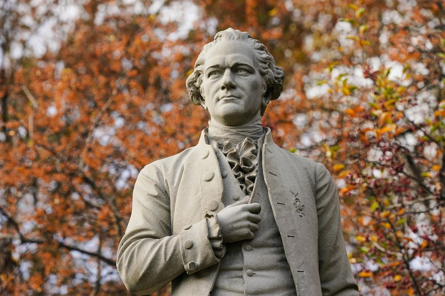 FILE - In this Tuesday, Nov. 10, 2020, file photo, a statue of Alexander Hamilton stands in Central Park in New York. A new research paper takes a swipe at the popular image of Alexander Hamilton as the abolitionist founding father, citing evidence that he was a slave trader and owner himself. (AP Photo/Frank Franklin II, File)