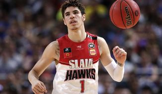 FILE - In this Nov. 17, 2019, file photo, LaMelo Ball of the Illawarra Hawks brings the ball up during a game against the Sydney Kings in the Australian Basketball League in Sydney. Ball is expected to be the first point guard taken and possibly the No. 1 overall pick in the NBA draft on Nov. 18, 2020. (AP Photo/Rick Rycroft, File)
