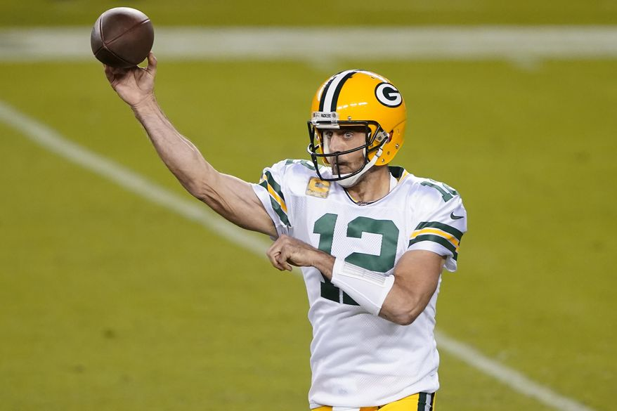 Green Bay Packers quarterback Aaron Rodgers (12) passes against the San Francisco 49ers during the first half of an NFL football game in Santa Clara, Calif., Thursday, Nov. 5, 2020. (AP Photo/Tony Avelar)