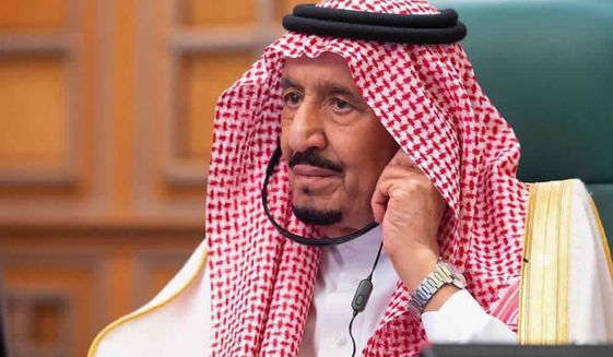 FILE - In this photo released by Saudi Press Agency, SPA, Saudi King Salman, chairs a video call of world leaders from the Group of 20 and other international bodies and organizations, from his office in Riyadh, Saudi Arabia, on March 26, 2020. Saudi King Salman is expected to speak Wednesday, Nov. 11, 2020, in an annual (virtual) address he gives to the nation about policy priorities for the coming year. (Saudi Press Agency via AP)