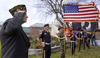 Chaplain Charles Andriolo, of VFW Post 1617, salutes during a Veteran's Day ceremony, Wednesday, Nov. 11, 2020, in Derry, N.H. (AP Photo/Charles Krupa)