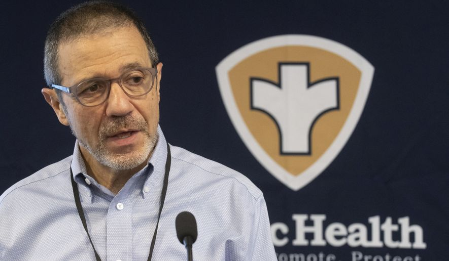 Gianfranco Pezzino, Shawnee County health officer, explains new health orders during a coronavirus press conference Friday, Aug. 21, 2020, at the Shawnee County health department in Topeka, Kan. ==(Evert Nelson/The Topeka Capital-Journal via AP)