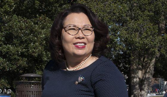 Sen. Tammy Duckworth, D-Ill., arrives at the Capitol in Washington on Jan. 22, 2020. (AP Photo/Cliff Owen) ** FILE **