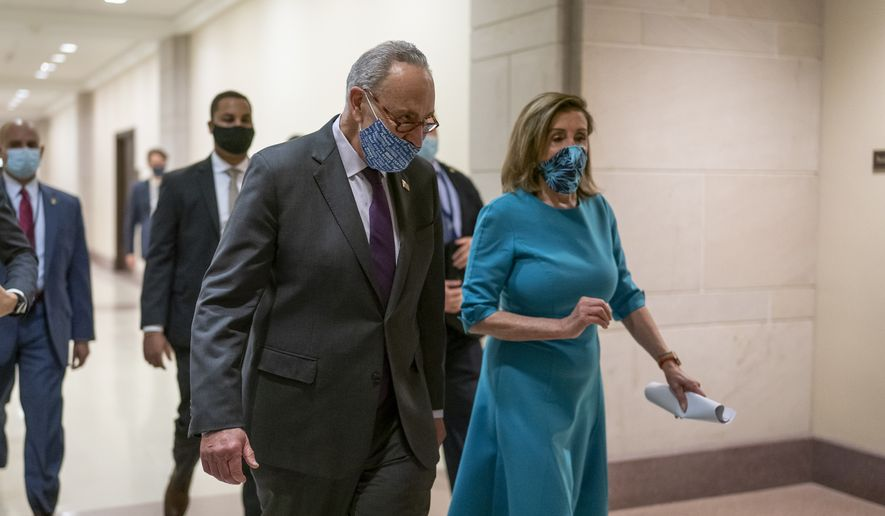 Speaker of the House Nancy Pelosi, D-Calif., and Senate Minority Leader Chuck Schumer, D-N.Y., confer following a meeting with reporters on Capitol Hill in Washington, Thursday, Nov. 12, 2020. (AP Photo/J. Scott Applewhite)