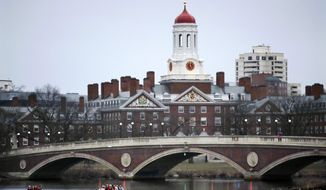 FILE - In this March 7, 2017, file photo, rowers paddle along the Charles River past the Harvard University campus in Cambridge, Mass. A federal appeals court on Thursday, Nov. 12, 2020 has upheld a district court decision clearing Harvard University of intentional discrimination against Asian American applicants. (AP Photo/Charles Krupa, File)
