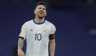 Argentina's Lionel Messi reacts during a qualifying soccer match against Paraguay for the FIFA World Cup Qatar 2022 in Buenos Aires, Argentina, Thursday, Nov. 12, 2020.(Juan Roncoroni, Pool via AP)