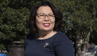 "FILE - Sen. Tammy Duckworth, D-Ill., arrives at the Capitol in Washington on Jan. 22, 2020. Duckworth' memoir titled ""Every Day Is a Gift"" comes out March 30. The Hachette Book Group imprint Twelve announced the deal with Sen. Duckworth on Thursday, Nov. 12, 2020, on the 16th anniversary of when she was shot down while serving in Iraq and lost both of her legs. (AP Photo/Cliff Owen, File)"