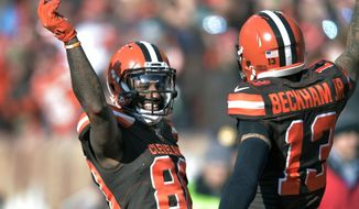 FILE - In this Sunday, Nov. 24, 2019 file photo, Cleveland Browns wide receiver Jarvis Landry (80) celebrates with Cleveland Browns wide receiver Odell Beckham Jr. (13) after Landry scored a 7-yard touchdown during the first half of an NFL football game against the Miami Dolphins in Cleveland. Every day on the practice field, Jarvis Landry looks around and expects to see Odell Beckham Jr. dancing during warmups or running pass routes alongside him. But his best friend and teammate isn't around _ and won't be until next year. (AP Photo/David Richard, File)