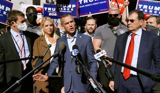 President Donald Trump's campaign advisor Corey Lewandowski, center, speaks outside the Pennsylvania Convention Center where votes are being counted, Thursday, Nov. 5, 2020, in Philadelphia, following Tuesday's election. At left is former Florida Attorney General Pam Bondi. (AP Photo/Matt Slocum)