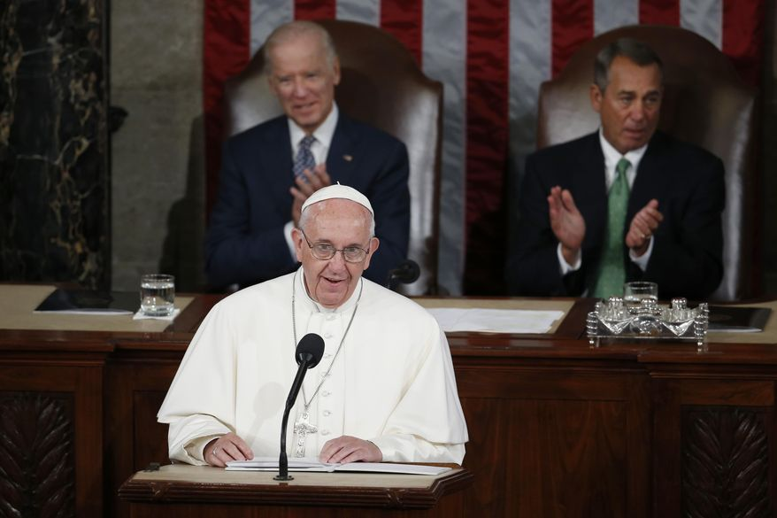 FILE - In this Thursday, Sept. 24, 2015 file photo, Pope Francis addresses a joint meeting of Congress on Capitol Hill in Washington, making history as the first pontiff to do so. Listening behind the pope are Vice President Joe Biden and House Speaker John Boehner of Ohio. President-elect Joe Biden, a lifelong Roman Catholic, spoke to Pope Francis on Thursday, Nov. 12, 2020, despite President Donald Trump refusing to concede. Trump claims — without evidence — that the election was stolen from him through massive but unspecified acts of fraud. (AP Photo/Carolyn Kaster)