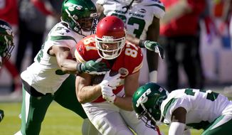 New York Jets' Avery Williamson (54) and Brian Poole, right, combine to stop Kansas City Chiefs tight end Travis Kelce (87) from gaining extra yardage after a catch in the first half of an NFL football game on Sunday, Nov. 1, 2020, in Kansas City, Mo. (AP Photo/Jeff Roberson)