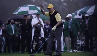 Jack Nicklaus waves after hitting a ceremonial first ball before the first round of the Masters golf tournament Thursday, Nov. 12, 2020, in Augusta, Ga. (AP Photo/David J. Phillip)