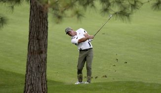 Paul Casey hits out of the 7th fairway during the first round of the Masters golf tournament Thursday, Nov. 12, 2020, in Augusta, Ga. (Curtis Compton/Atlanta Journal-Constitution via AP)