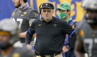 Pittsburgh head coach Pat Narduzzi wears a face shield as he watches his team play against Notre Dame during the first half of an NCAA college football game, Saturday, Oct. 24, 2020, in Pittsburgh. Narduzzi says Georgia Tech quarterback Jeff Sims' growth in making decisions is impressive for a freshman. Pitt's fierce pass rush will be a new test for Sims' ability to remain poised in the pocket on Saturday night. (AP Photo/Keith Srakocic, File) **FILE**
