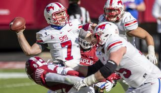 SMU quarterback Shane Buechele (7) throws during the first half of an NCAA college football game against Temple, Saturday, Nov. 7, 2020, in Philadelphia. SMU won 47-23. (AP Photo/Laurence Kesterson)
