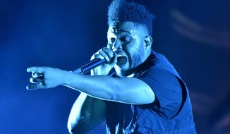 The Weeknd performs on day three at Lollapalooza in Chicago on Aug 4, 2018.  The NFL, Pepsi and Roc Nation announced Thursday, Nov. 12 that the three-time Grammy winner will perform at the 2021 Pepsi Super Bowl Halftime Show on Feb. 7 at Raymond James Stadium in Tampa, Florida. (Photo by Rob Grabowski/Invision/AP, File)