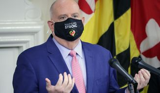 Maryland Gov. Larry Hogan takes questions from journalists during a news conference on Thursday, Nov. 12, 2020 in Annapolis, Md., where the governor announced how about $70 million in federal money will be used to help fight the virus. (AP Photo/Brian Witte)