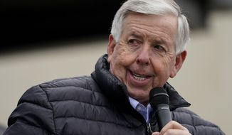 FILE - Missouri Republican Gov. Mike Parson speaks during a campaign rally at a gun store Sunday, Oct. 25, 2020, in Lees Summit, Mo. Parson on Thursday, Nov. 12, 2020 announced a change in guidance for when K-12 students and staff should quarantine. The change states that if the person diagnosed with COVID-19 and the person exposed are both wearing face coverings, the exposed person does not need to quarantine. (AP Photo/Charlie Riedel,File)