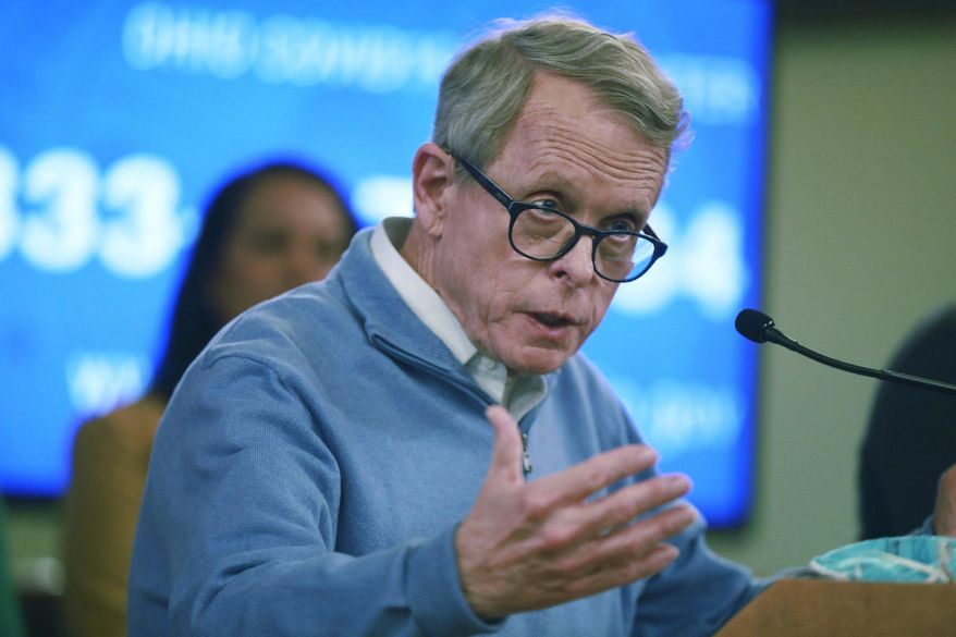 In this photo from March 14, 2020, Ohio Gov. Mike DeWine speaks at a coronavirus news conference at the Ohio Statehouse in Columbus, Ohio. (Doral Chenoweth/The Columbus Dispatch via AP) **FILE**