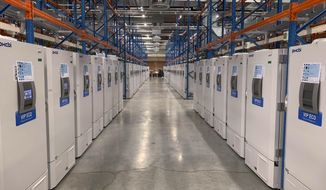 "This handout photo taken in October 2020 and provided by Pfizer shows part of a ""freezer farm,"" a football field-sized facility for storing finished COVID-19 vaccines, in Puurs, Belgium. Pfizer's experimental vaccine requires ultra-cold storage and are being stored in special freezers until approval and distribution. Pfizer Inc. said Monday, Nov. 9, 2020, that its COVID-19 vaccine may be a remarkable 90% effective, based on early and incomplete test results that nevertheless brought a big burst of optimism to a world desperate for the means to finally bring the catastrophic outbreak under control. (Pfizer via AP)"