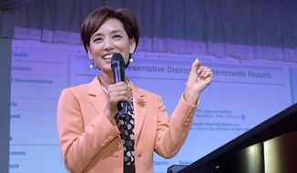 In this Nov. 6, 2018, file photo, Young Kim, then a Republican candidate for the 39th Congressional District in California, speaks to supporters in the Rowland Heights section of Los Angeles. This year, Kim narrowly defeated Democratic Rep. Gil Cisneros in a Southern California district the GOP lost two years ago. Kim, a former state legislator, won her rematch with Cisneros and gave Republicans their second House victory over a Democratic incumbent in Orange County this election. (AP Photo/Mark J. Terrill, File)