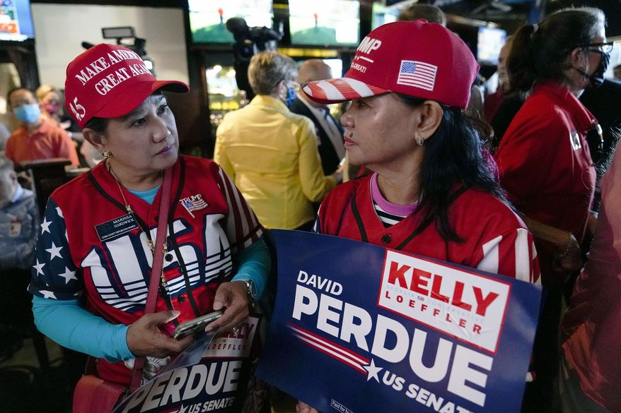 Republican supporters wait for U.S. Senate Sen. Kelly Loeffler, and Sen. David Perdue to speak during a campaign rally on Friday, Nov. 13, 2020, in Cumming, Ga. (AP Photo/Brynn Anderson) **FILE**