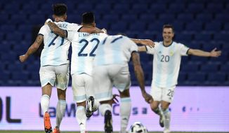 Argentina's Nicolas Gonzalez, left, celebrates scoring his side's first goal against Paraguay with teammates during a qualifying soccer match for the FIFA World Cup Qatar 2022 in Buenos Aires, Argentina, Thursday, Nov. 12, 2020.(Marcelo Endelli, Pool via AP)