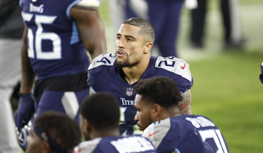 Tennessee Titans strong safety Kenny Vaccaro (24) sits on the sideline in the second half of an NFL football game against the Indianapolis Colts Thursday, Nov. 12, 2020, in Nashville, Tenn. (AP Photo/Wade Payne)
