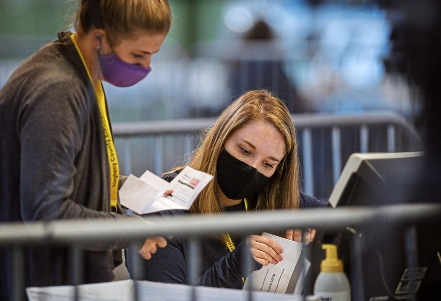 Members of the Allegheny County Return Board process the remaining absentee and mail-in Allegheny County ballots, Thursday, Nov. 12, 2020, on the North Side in Pittsburgh. (Steve Mellon/Pittsburgh Post-Gazette via AP) ** FILE **
