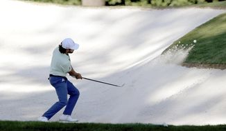 Abraham Ancer hits his bunker shot on the 3rd hole during the second round of the Masters Friday, Nov. 13, 2020, in Augusta, Ga. (Curtis Compton/Atlanta Journal-Constitution via AP)
