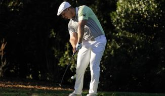 Bryson DeChambeau tees off on the seventh hole during the second round of the Masters golf tournament Friday, Nov. 13, 2020, in Augusta, Ga. (AP Photo/Charlie Riedel)
