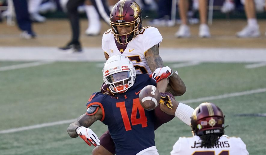 Minnesota defensive back Benjamin St-Juste breaks up a pass intended for Illinois punter Blake Hayes (14) during the first half of an NCAA college football game Saturday, Nov. 7, 2020, in Champaign , Ill. (AP Photo/Charles Rex Arbogast)