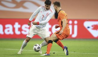 Spain's Alvaro Morata, left, and Netherlands' Joel Veltman vie for the ball during the international friendly soccer match between The Netherlands and Spain at the Johan Cruyff ArenA in Amsterdam, Netherlands, Wednesday, Nov. 11, 2020. (Dean Mouhtaropoulos/Pool via AP)