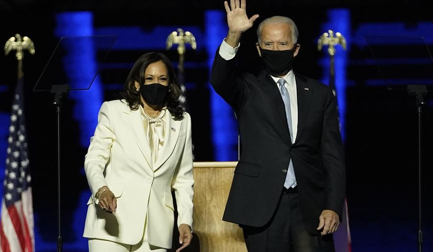 President-elect Joe Biden, right, shares the stage with Vice President-elect Kamala Harris, left, Saturday, Nov. 7, 2020, in Wilmington, Del. (AP Photo/Andrew Harnik, Pool)