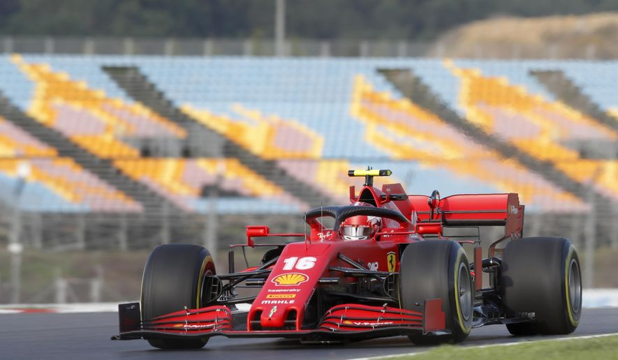 Ferrari driver Charles Leclerc of Monaco steers his car during a practice session at the Istanbul Park circuit racetrack in Istanbul, Friday, Nov. 13, 2020. The Formula One Turkish Grand Prix will take place on Sunday. (Murad Sezer/Pool via AP)