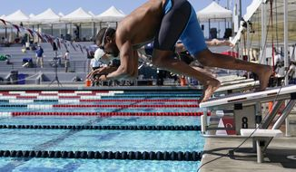 Ous Mellouli dives in for the men's 400 meter freestyle at the U.S. Open swimming championships Friday, Nov. 13, 2020, in Irvine, Calif. (AP Photo/Ashley Landis)